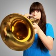 Portrait of a young girl blowing trumpet — Stock Photo #12094445