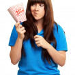 Stock Photo: Girl holding empty popcorn packet