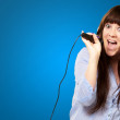 Girl With Headset Singing On Mike — Stock Photo #12094572