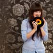 Woman Biting Disc - Stockfoto