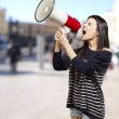Woman with a megaphone — Stock Photo #12095169