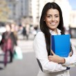 Woman holding a notebook — Stock Photo