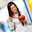 Portrait of healthy young woman eating cereals indoor — Stock Photo #12095200