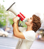 Portrait Of Young Man Shouting With A Megaphone  — Stock Photo