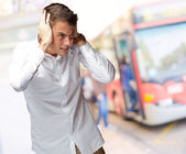 Portrait Of Young Man Covering His Ears With Hand — Stock Photo
