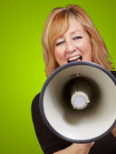 Woman screaming on a megaphone — Stock Photo