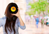Young Girl Looking At Vinyl — Stock Photo