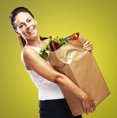 Woman with purchase — Stockfoto
