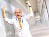Senior Male Doctor In A Winning Gesture — Foto de Stock