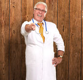 Portrait Of A Senior Doctor Pointing — Stock Photo