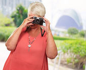 Senior Woman Clicking Photo — Stock Photo