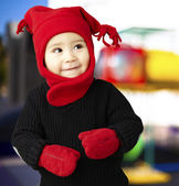 Portrait of an adorable kid smiling wearing winter clothes again — Stock Photo