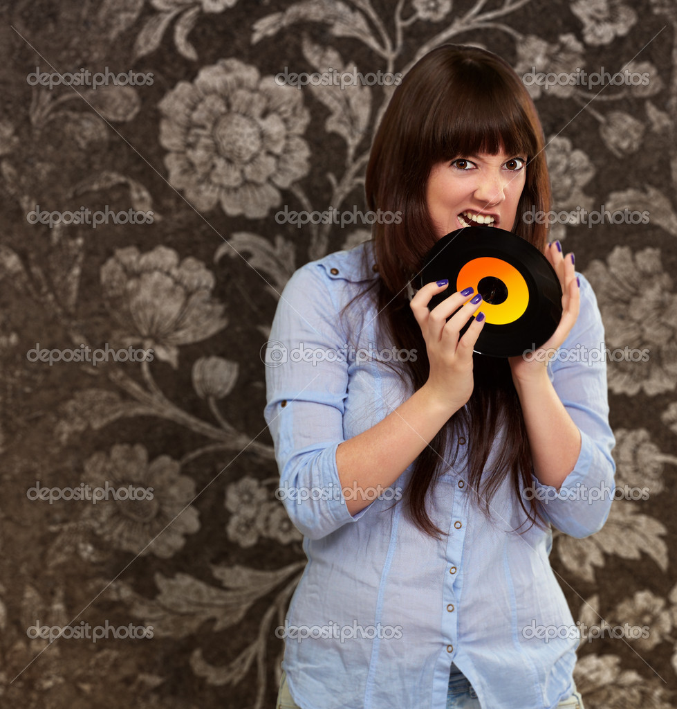 Woman Biting Disc, Indoor  Stock Photo #12094609