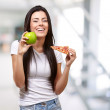 Female Holding A Piece Of Pizza And A Apple — Stock Photo #12278062