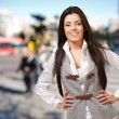 Portrait of a happy girl smiling at crowded street — Stock Photo