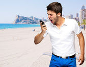Portrait of young man arguing against a beach — Stock Photo