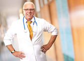 Senior Man Doctor With Hand On Hip — Stock Photo