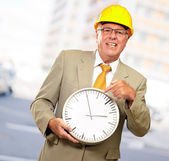 Portrait Of A Senior Man Holding A Wall Watch — Stock Photo