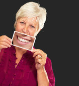 Senior Woman With Magnifying Glass Showing Teeth — Stock Photo