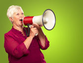 Portrait Of A Senior Woman With Megaphone — Stock Photo