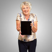 Portrait Of A Senior Woman Holding A Digital Tablet — Stock Photo