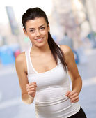 Healthy young girl running at city — Stock Photo