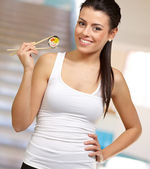 Female Holding A Sushi With Chopstick — Stock Photo