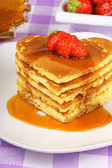 Stack of heart shaped pancakes with syrup and strawberry — Stock Photo