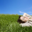 Woman lyind on green meadow — Stock Photo