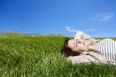 Woman lyind on green meadow — Stock Photo