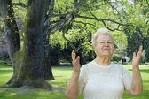 Senior woman enjoying spring — Stock Photo
