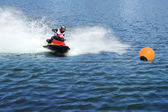 Jetski racing on a blue water background — Stock Photo