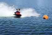 Jetski racing on a blue water background — Stock Photo
