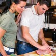 Couple preparing lunch in kitchen — Stock Photo #11643554
