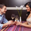 Young couple drinking wine and flirting — Stock Photo #11643556
