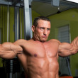 Muscle shaped man exercise on sport gym fitness club — Stock Photo