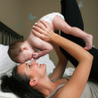 Mother with baby having fun — Stock Photo