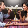 Young couple drinking wine and flirting — Stock Photo #11643585