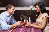 Young couple drinking wine and flirting — Stock Photo