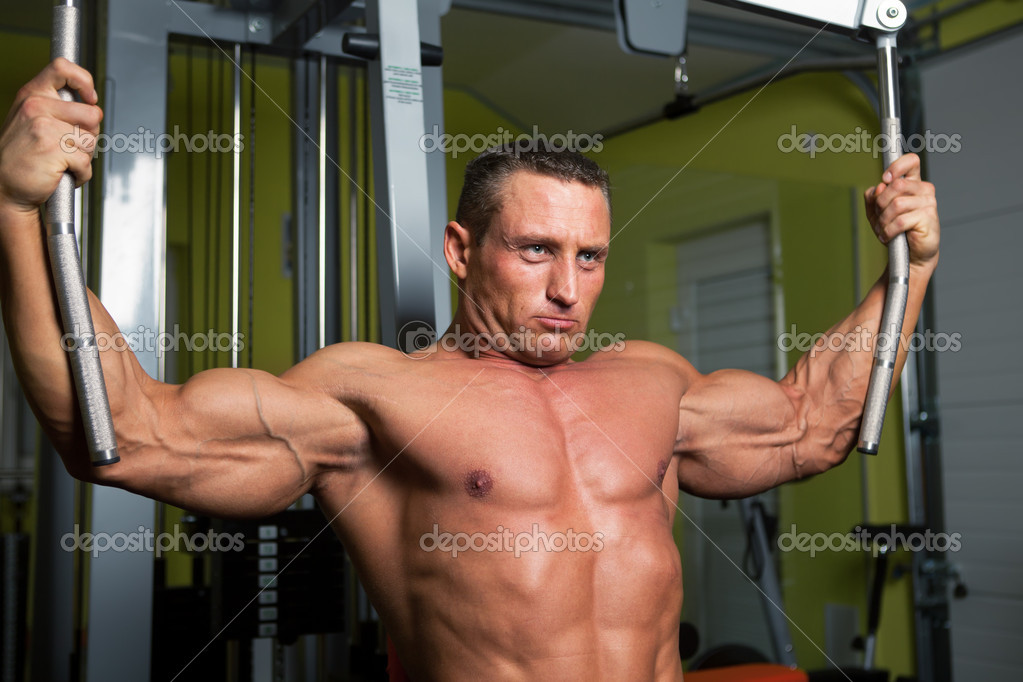 Muscle shaped man exercise on sport gym fitness club — Stock Photo #11643560