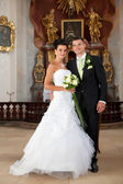 Young couple just married inside of church — Stock Photo