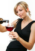 Woman pouring a glass of red wine — Stock Photo