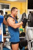 Strong man preparing his training machine — Stock Photo