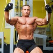 Stock Photo: Muscle shaped man exercise on sport gym