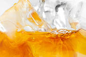 Whiskey and ice on white — Stock Photo