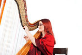 Girl playing on a Harp — Stock Photo