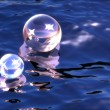 Stock Photo: Sparkling spheres in water
