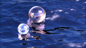 Sparkling spheres in water — Stock Photo