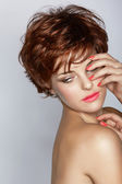Woman with short hair and pink manicure — Stock Photo