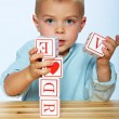 Boy playing with alphabet blocks — Stock Photo